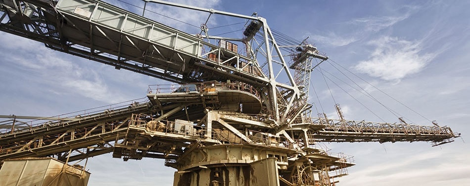 The Energy Cost of Friction and Wear in Mining