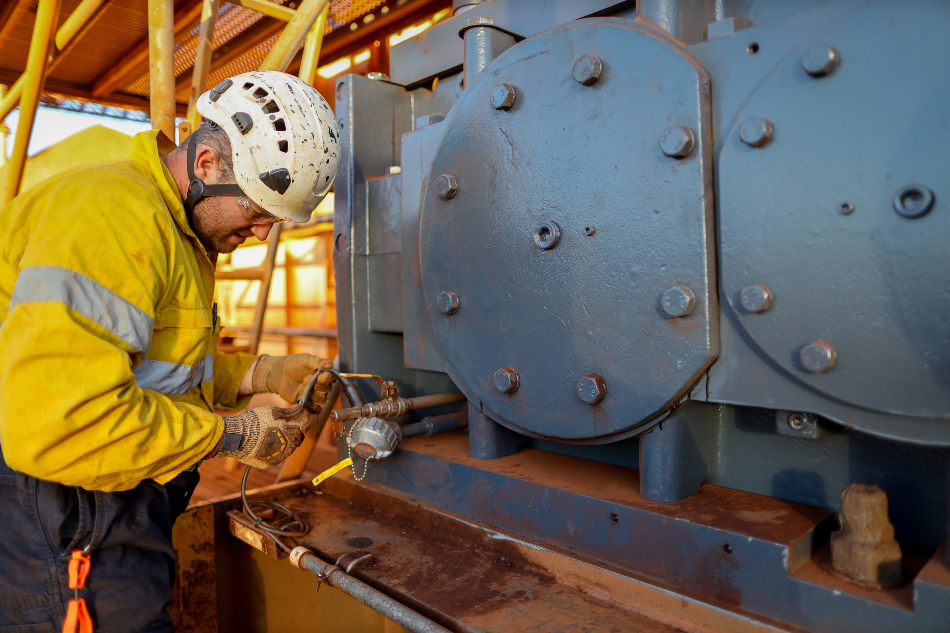 Miner electrician worker conducting safety inspection on wire cable power generator on the construction mine site plant, Sydney, Australia