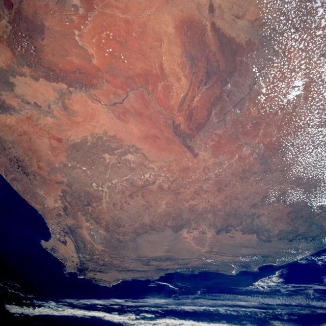 The reddish-brown Kalahari Desert.